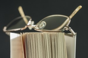 Reading Book with Spectacles